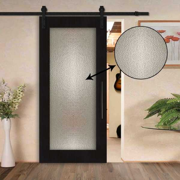 Sliding veneered barn door with hammered glass insert and carbon steel sliding system