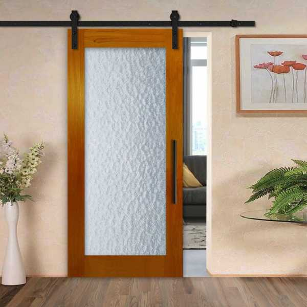 Solid mahogany sliding door with textured glass insert and carbon steel sliding system